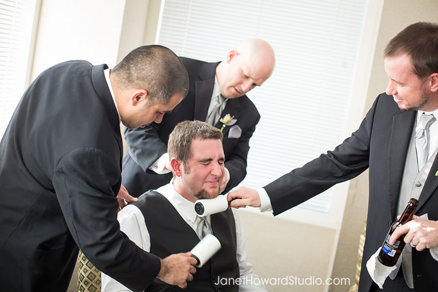 lint rolling the groom