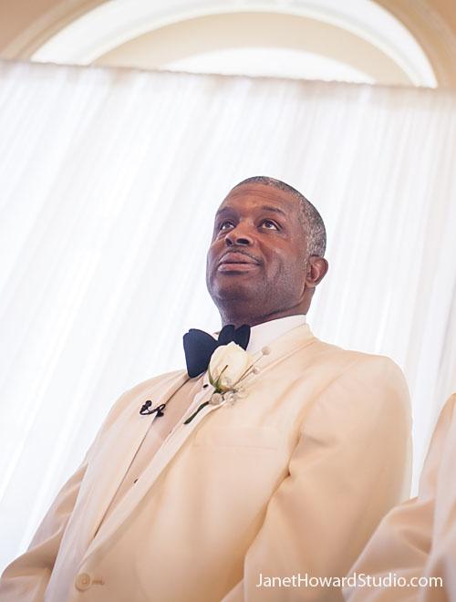 Groom watches bride enter